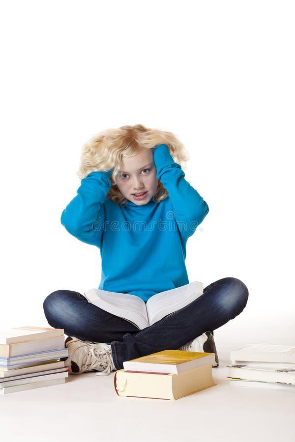 La pression d'exécuter frustre la fille d'école photo stock