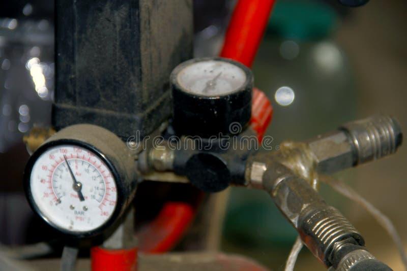 La pressione del compressore d'aria pompa la foto del primo piano fotografie stock libere da diritti