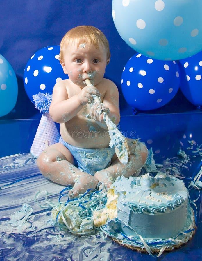 La prima torta di compleanno del bambino fotografia stock