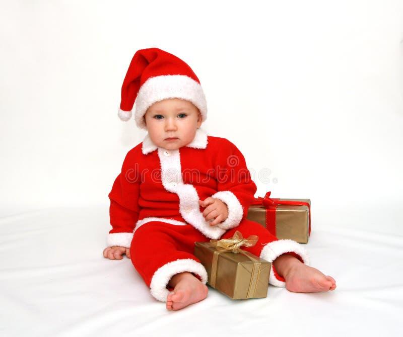 La primera Navidad del pequeño â de Papá Noel fotografía de archivo