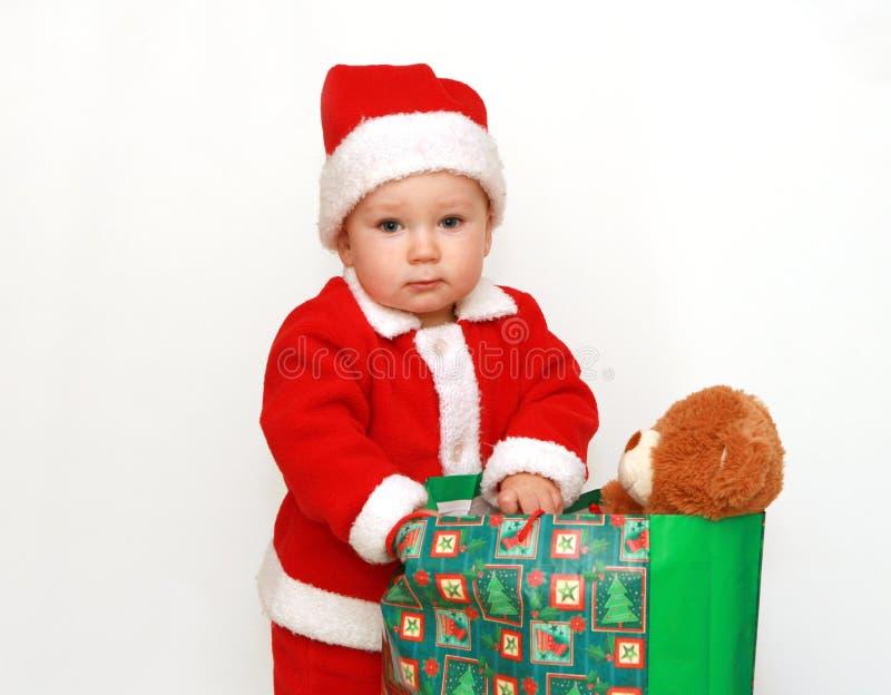 La primera Navidad del pequeño â de Papá Noel imagen de archivo
