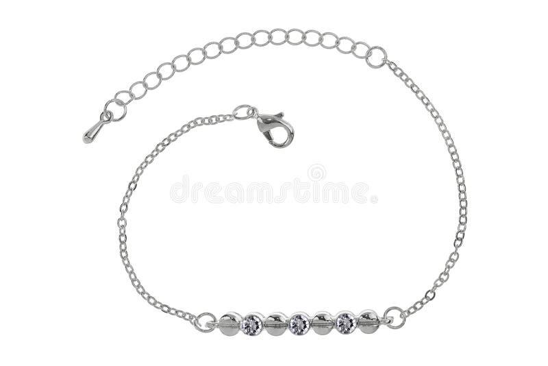 La pulsera de plata con tres diamantes, aislados en el fondo blanco, trayectoria de recortes incluyó imágenes de archivo libres de regalías