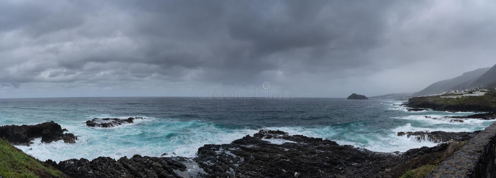 La Punta del Canto, Las Cruces, Tenerife, Espania - October 28, 2018: Panoramic view of La Punta del Canto from the town of Las. Cruces, across the Atlantic royalty free stock photography