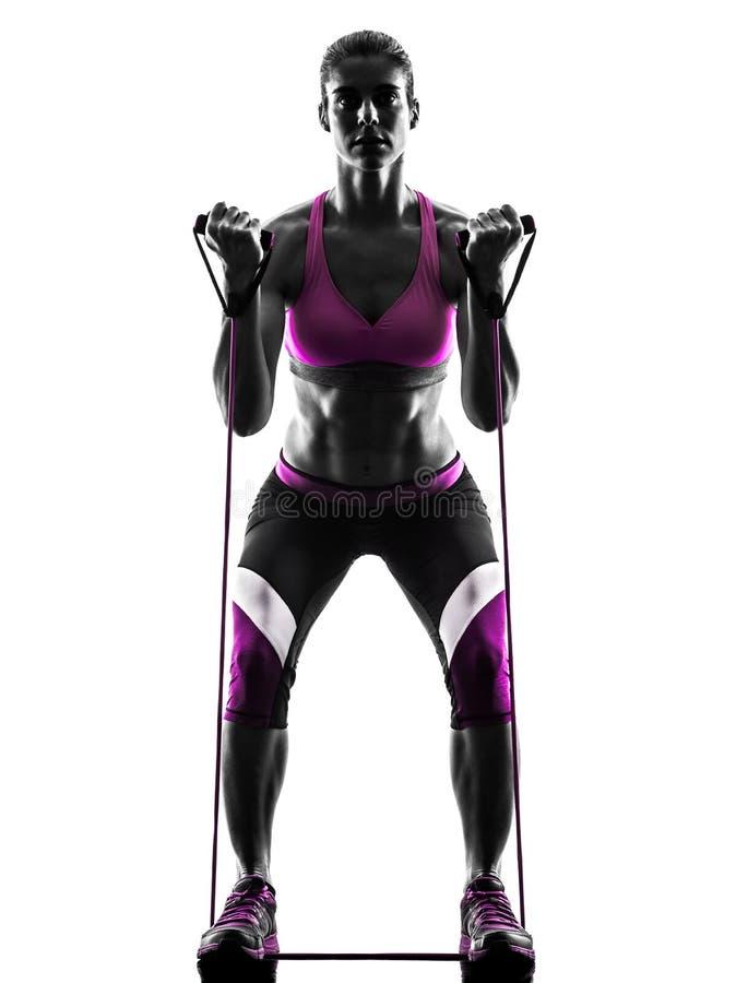 La résistance de forme physique de femme réunit la silhouette image libre de droits