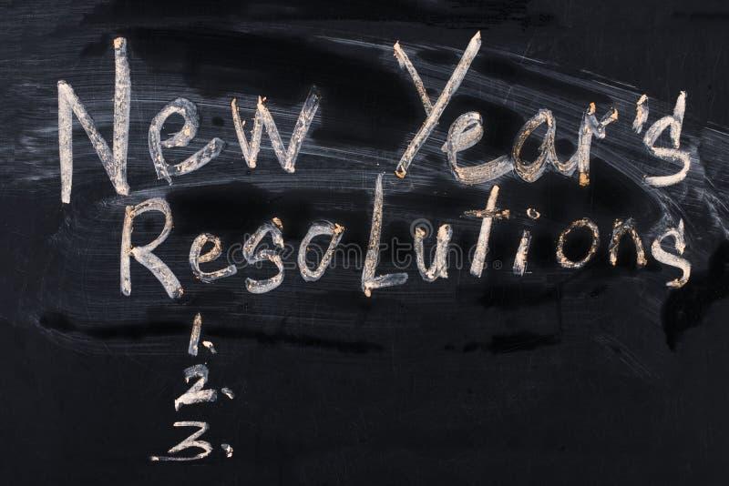 La résolution du ` s de nouvelle année de mot écrite sur le tableau noir photo stock
