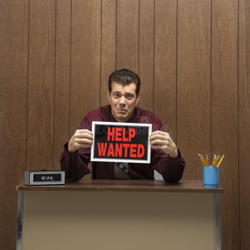 La rétro aide de fixation d'homme d'affaires a voulu le signe. photos stock