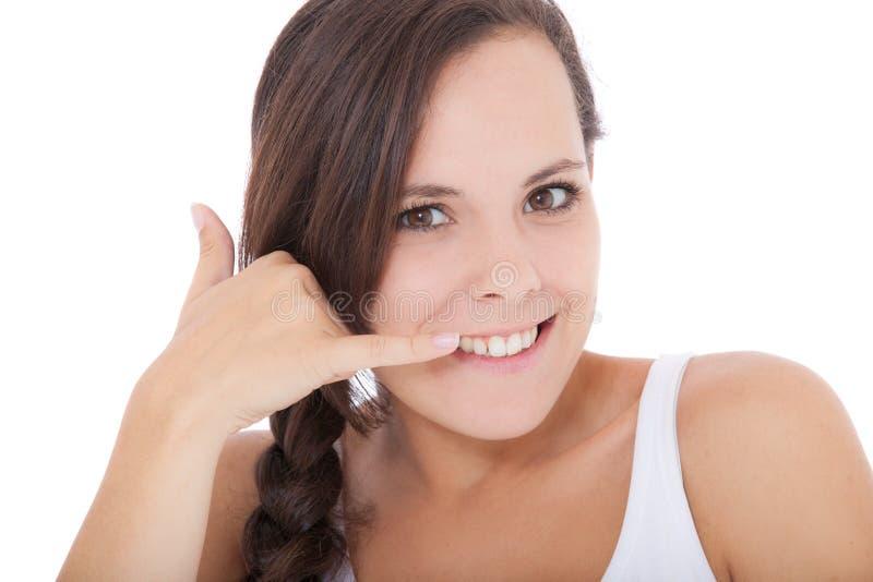 La ragazza attraente vi dà una chiamata fotografia stock