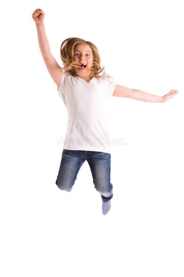 La ragazza bionda del bambino ha rientrato il vento forte di salto su capelli fotografie stock