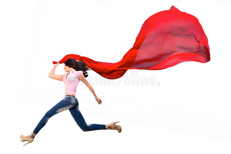 La ragazza che salta con il tessuto fotografia stock libera da diritti