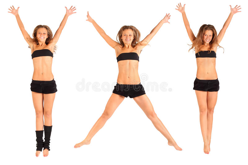 La ragazza che salta in su con le braccia alzate isolate fotografie stock libere da diritti
