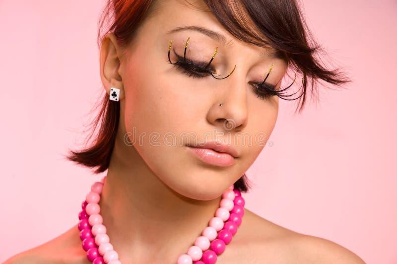 La ragazza con i cigli falsi fotografia stock libera da diritti