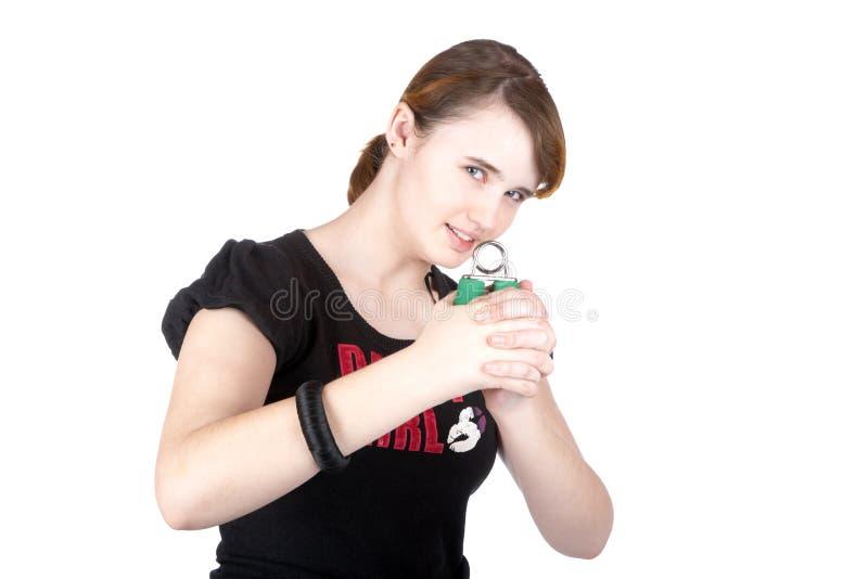 La ragazza con il flessore della mano immagini stock libere da diritti