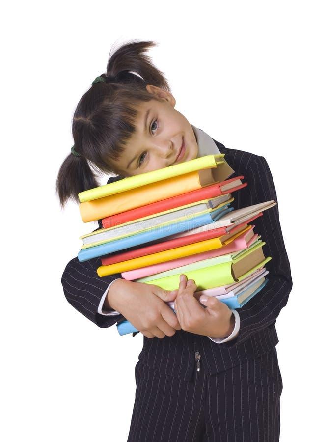 La ragazza con un mucchio dei libri fotografia stock libera da diritti