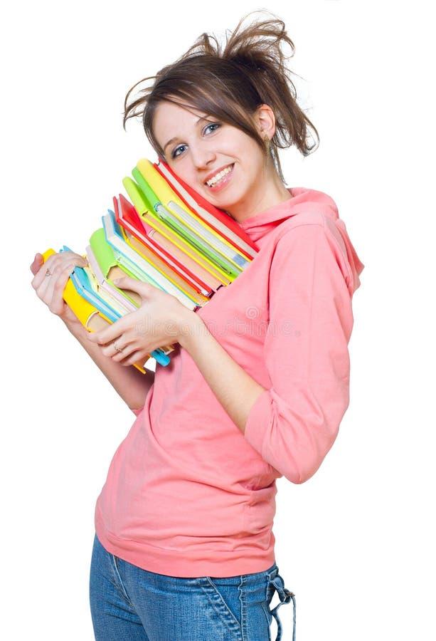 La ragazza con un mucchio dei libri fotografie stock