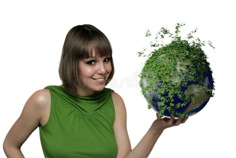 La ragazza con un pianeta verde immagine stock libera da diritti