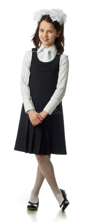 La ragazza della ciliegia in un uniforme scolastico fotografie stock