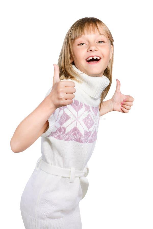 La ragazza di risata del preteen fa il pollice sul segno fotografie stock libere da diritti