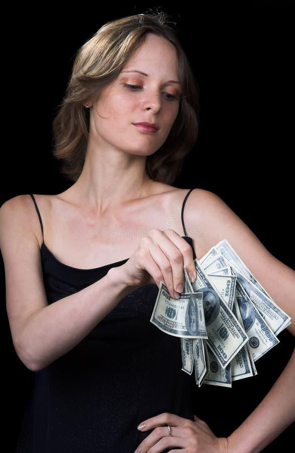La ragazza ed i soldi fotografia stock