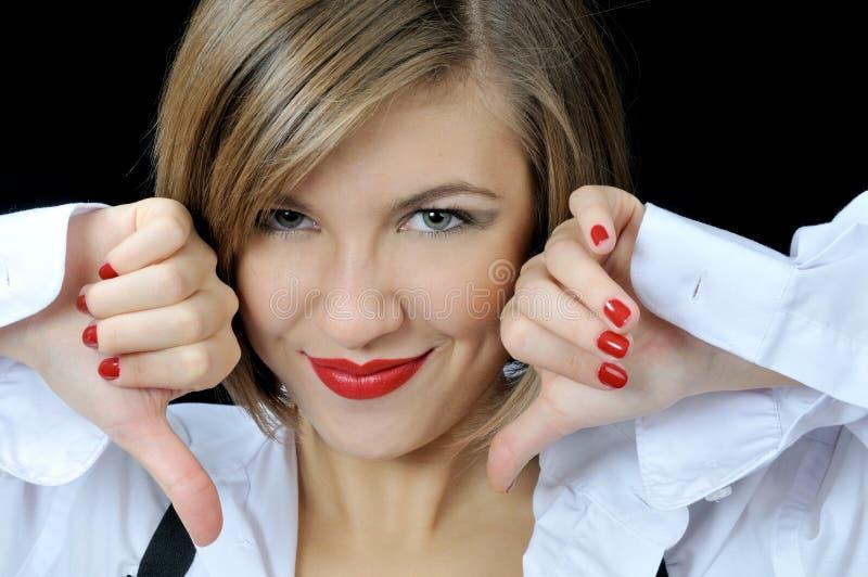 Download La Ragazza Graziosa Mostra I Tumbs Giù Fotografia Stock - Immagine di cura, ragazza: 7320002