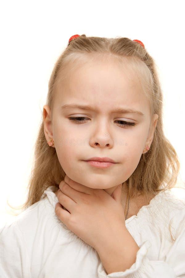 La ragazza ha una gola irritata immagine stock