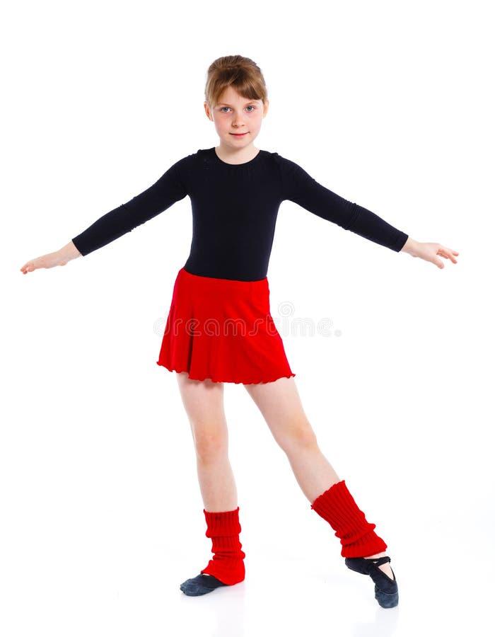 La ragazza i treni del gymnast fotografia stock