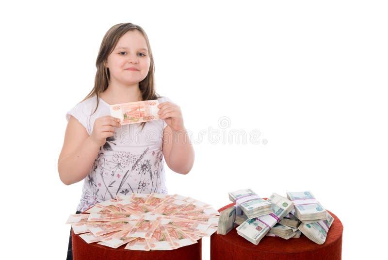 La ragazza mostra i soldi immagine stock