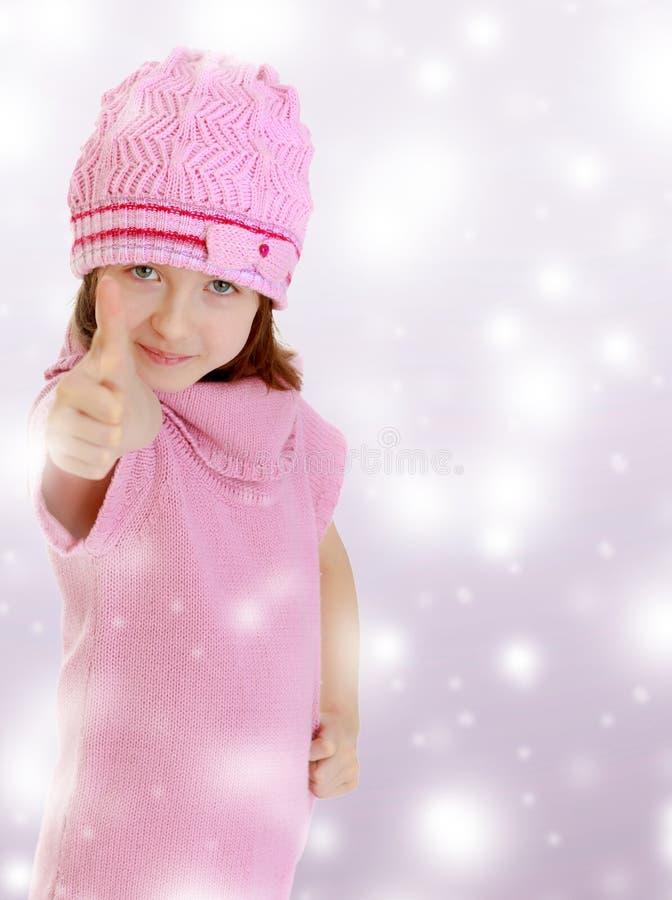La ragazza mostra il pollice su fotografia stock