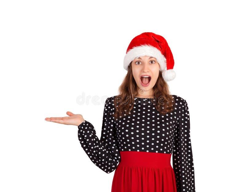 La ragazza nella sorpresa del vestito vi raccomanda per usare questo spazio della copia ragazza emozionale in cappello di natale  immagini stock