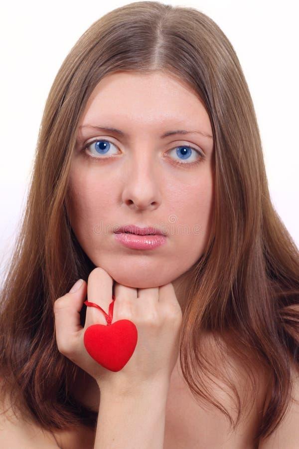 La ragazza piacevole con cuore fotografia stock