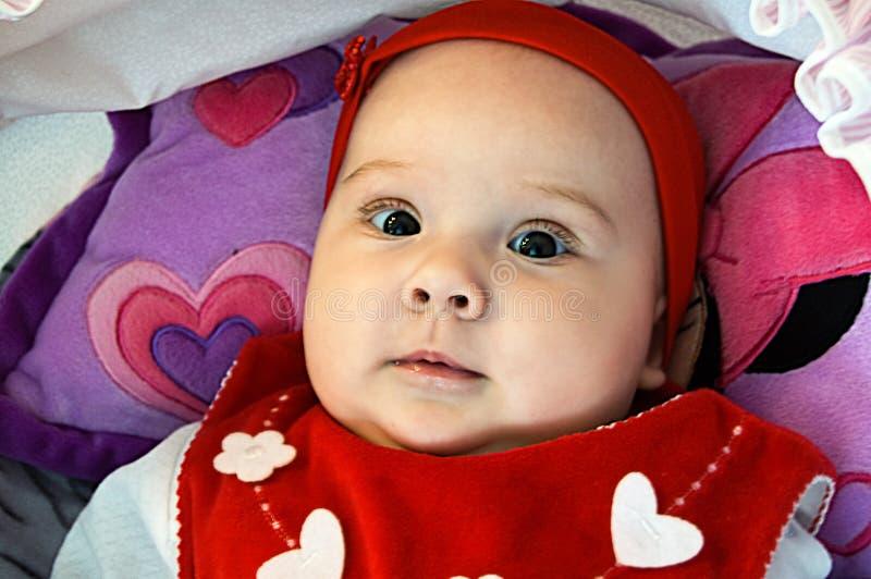 La ragazza piacevole con i grandi occhi immagine stock
