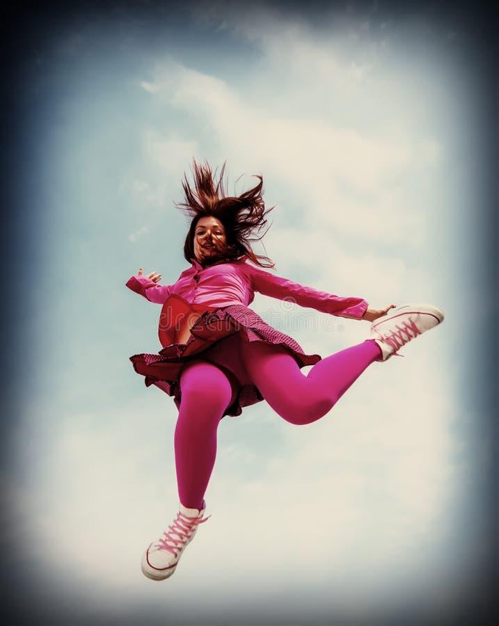 La ragazza saltata fotografia stock libera da diritti