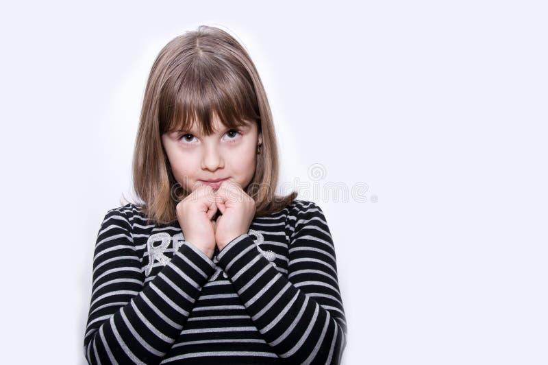 La ragazza teenager prega fotografie stock libere da diritti