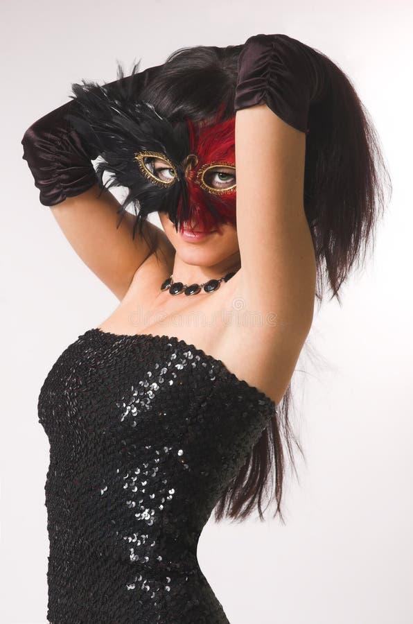 La ragazza in una mascherina fotografia stock libera da diritti