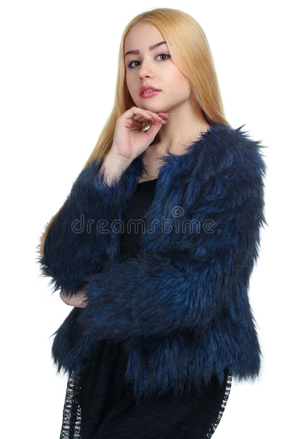 La ragazza in una pelliccia fotografia stock libera da diritti