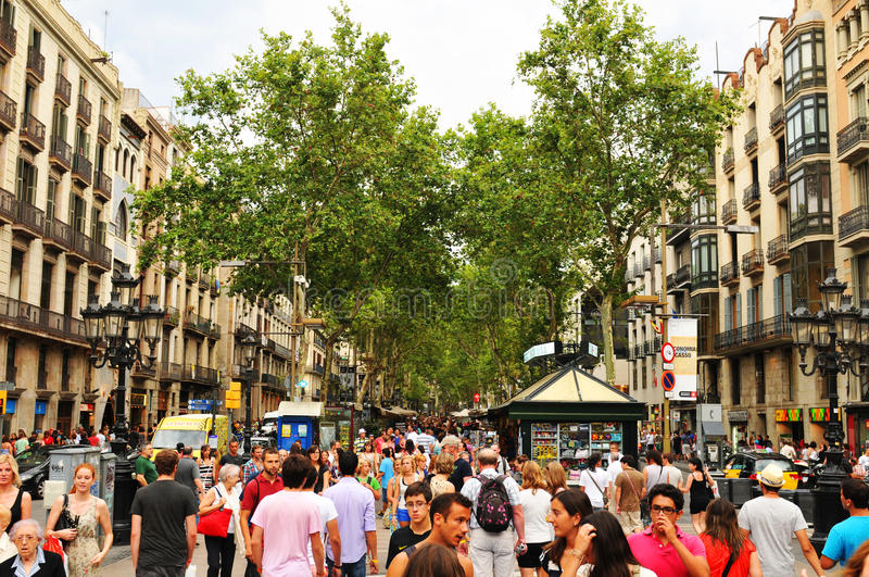 La Rambla, Barcelona. Barcelona, Spain - July 08, 2012: Crowds of tourists shopping in La Rambla, major commercial area in the centre of Barcelona stock images
