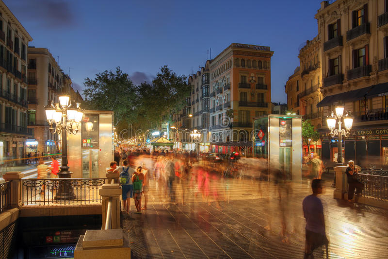 La Rambla, Barcelona, Spain. Night scene of La Rambla (Las Ramblas) in Barcelona, Spain in the close vicinity of the Liceu Theatre and Metro Station royalty free stock images