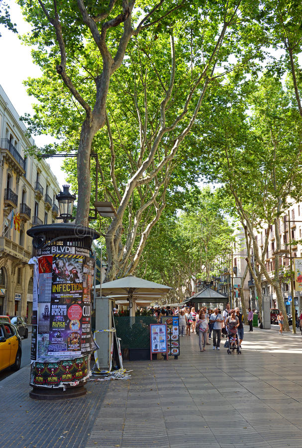 La Rambla in Barcelona. BARCELONA, SPAIN. CIRCA JUNE 2015. The always crowded, La Rambla in Barcelona is one of the more popular tourist draws to the city and is stock image