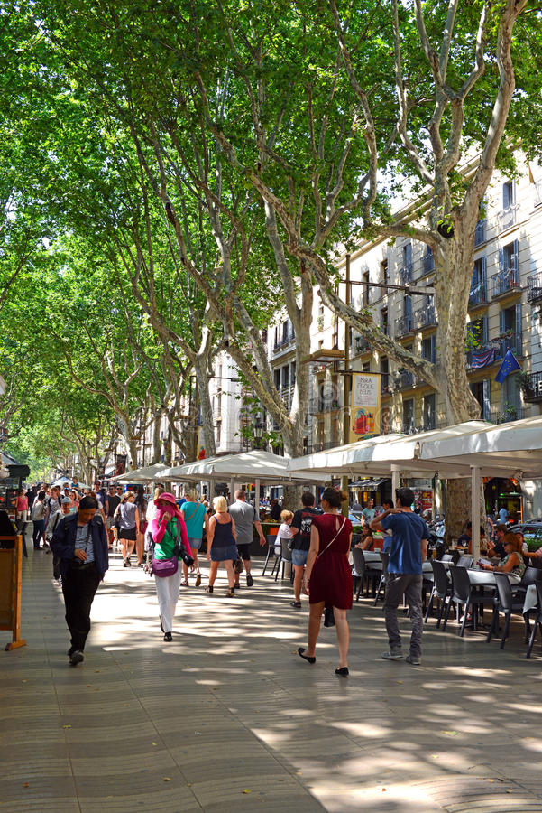 La Rambla in Barcelona. BARCELONA, SPAIN. CIRCA JUNE 2015. The always crowded, La Rambla in Barcelona is one of the more popular tourist draws to the city and is royalty free stock photo