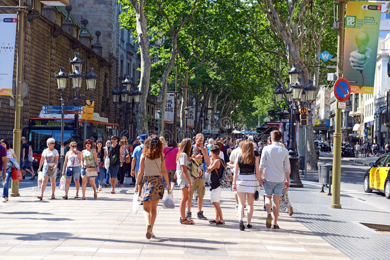 La Rambla in Barcelona. BARCELONA, SPAIN. CIRCA JUNE 2015. The always crowded, La Rambla in Barcelona is one of the more popular tourist draws to the city and is stock photos