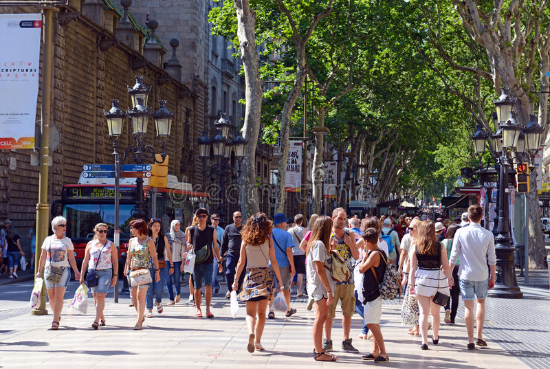 La Rambla in Barcelona. BARCELONA, SPAIN. CIRCA JUNE 2015. The always crowded, La Rambla in Barcelona is one of the more popular tourist draws to the city and is stock images