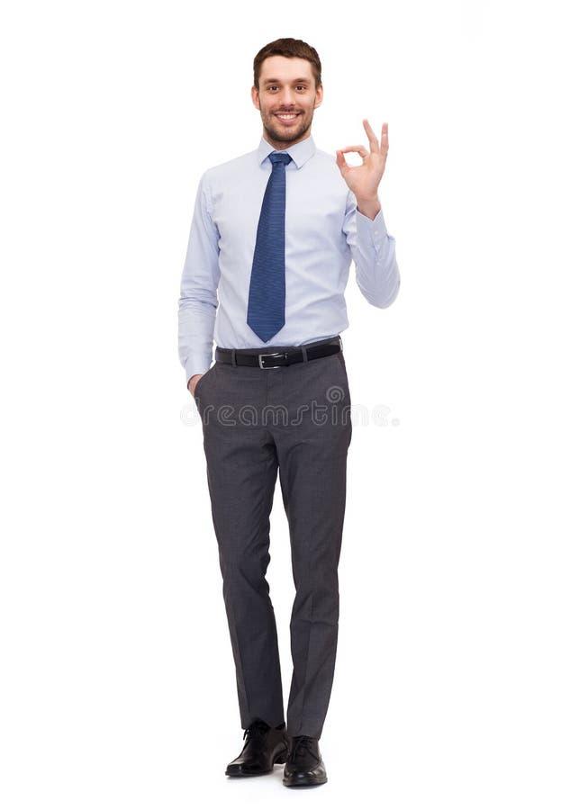 La rappresentazione bella dell'uomo d'affari giusto-canta immagine stock
