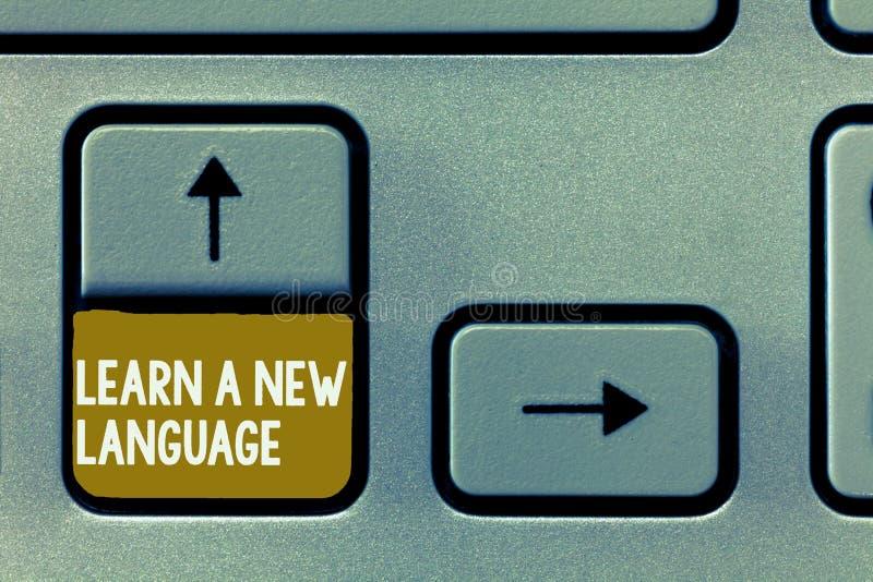 La rappresentazione concettuale di scrittura della mano impara una nuova lingua Foto di affari che montra le parole di studio all immagini stock