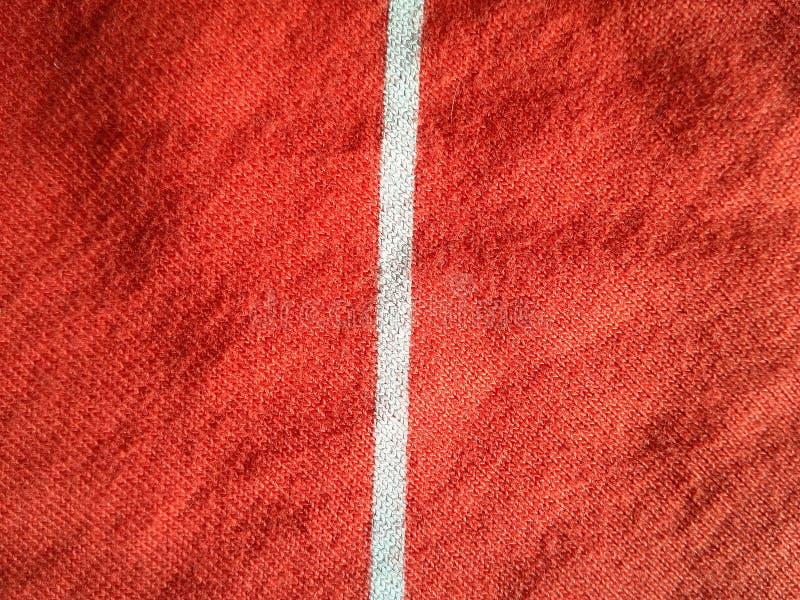 La rayure blanche sur le tissu orange photos libres de droits