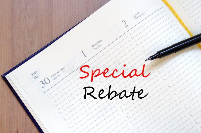 La rebaja especial escribe en el cuaderno imagen de archivo libre de regalías