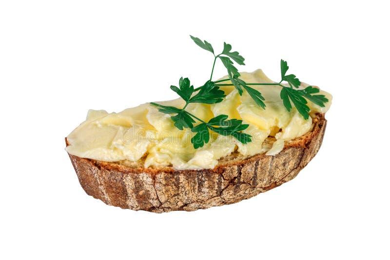 La rebanada de pan con mantequilla y perejil se aísla en la parte posterior del blanco fotos de archivo libres de regalías