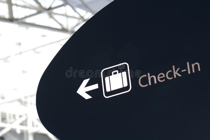 La registrazione firma dentro l'aeroporto immagini stock