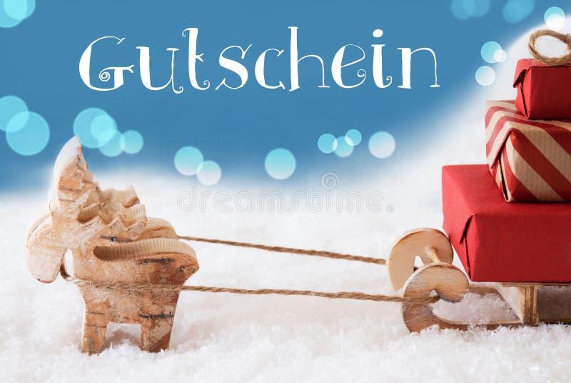 La renna, slitta, fondo blu-chiaro, Gutschein significa il buono fotografie stock