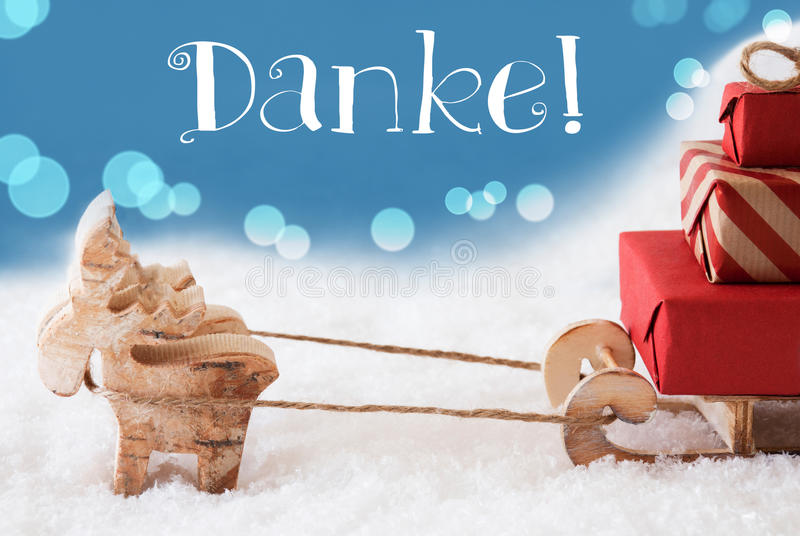 La renna, slitta, fondo blu-chiaro, mezzi di Danke vi ringrazia fotografie stock