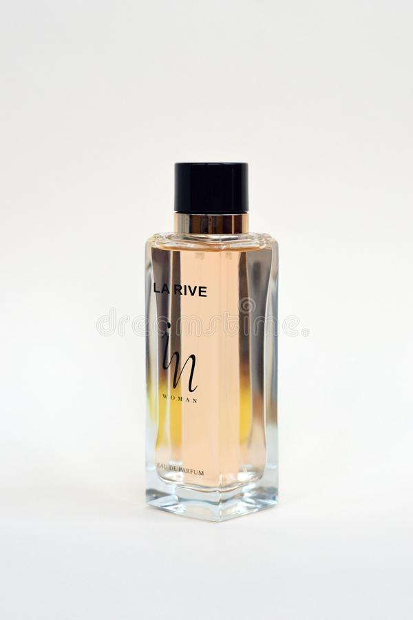 La rive IN woman perfume bottle on beige background. LA RIVE S.A. is one of the leading producers of perfumes and perfumed waters royalty free stock photography