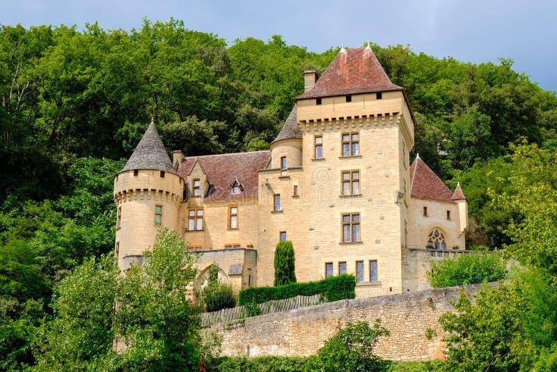 LA ROQUE GAGEAC, FRANCE - AUGUST 09, 2018: Picturesque castle near the village under rocks. Chateau de la Malatrie royalty free stock photos